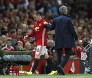 "Football Soccer Britain - Manchester United v Southampton - Premier League - Old Trafford - 19/8/16 Manchester United's Wayne Rooney shakes the hand of manager Jose Mourinho as he is substituted off Action Images via Reuters / Jason Cairnduff Livepic EDITORIAL USE ONLY. No use with unauthorized audio, video, data, fixture lists, club/league logos or ""live"" services. Online in-match use limited to 45 images, no video emulation. No use in betting, games or single club/league/player publications.  Please contact your account representative for further details. - RTX2M5O2"
