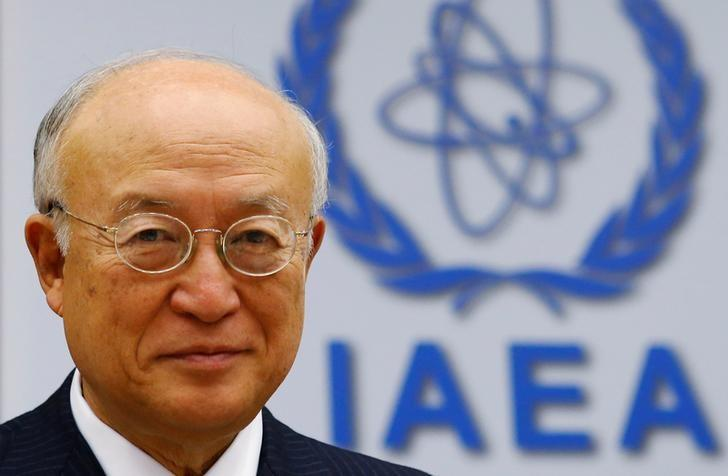 International Atomic Energy Agency (IAEA) Director General Yukiya Amano smiles as he waits for a board of governors meeting to begin at the IAEA headquarters in Vienna, Austria June 6, 2016. REUTERS/Heinz-Peter Bader/File Photo