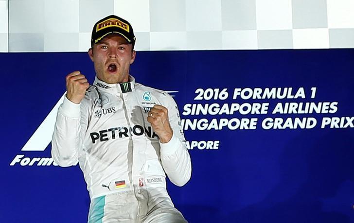 Formula One - F1 - Singapore Grand Prix - Marina Bay, Singapore- 18/9/16 Mercedes' Nico Rosberg of Germany celebrates winning the race . REUTERS/Jeremy Lee