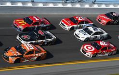 Feb 21, 2016; Daytona Beach, FL, USA; NASCAR Sprint Cup Series driver Carl Edwards (19), Kevin Harvick (4), Jaime McMurray (1), Ryan Blaney (21), Brad Keselowski (2) and Kyle Larson (42) during the Daytona 500 at Daytona International Speedway. Mike DiNovo-USA TODAY Sports