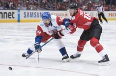 Sep 17, 2016; Toronto, Ontario, Canada; Team Canada forward Jonathan Toews (16) battles for a puck with Team Czech Republic player Tomas Plekanec (14) during the first period in the preliminary round play in the 2016 World Cup of Hockey at Air Canada Centre. Mandatory Credit: Nick Turchiaro-USA TODAY Sports