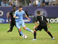 Sep 1, 2016; New York, NY, USA; NYCFC midfielder Frank Lampard (8) plays the ball while being defended by D.C. United midfielder Marcelo Sarvas (7) during the first half at Yankee Stadium. Mandatory Credit: Andy Marlin-USA TODAY Sports