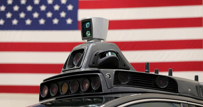 A roof mounted camera and radar system is shown on Uber's Ford Fusion self driving car during a demonstration of self-driving automotive technology in Pittsburgh, Pennsylvania, U.S. September 13, 2016.  REUTERS/Aaron Josefczyk