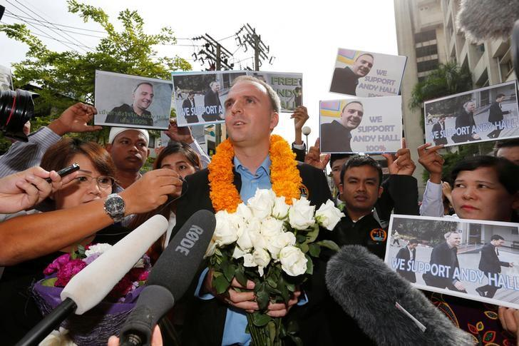 British rights activist Andy Hall speaks to member of media as he arrives at the Bangkok South Criminal Court to hear court verdict on charges of defamation and computer crimes over a report on alleged ill-treatment of migrants, in Bangkok, Thailand September 20, 2016. REUTERS/Chaiwat Subprasom