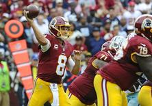 Sep 18, 2016; Landover, MD, USA; Washington Redskins quarterback Kirk Cousins (8) attempts a pass against the Dallas Cowboys during the second half  at FedEx Field. The Dallas Cowboys won 27 - 23. Mandatory Credit: Brad Mills-USA TODAY Sports