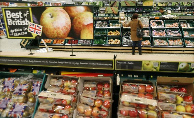 A customer shops in the produce department at a Tesco shop in Bishop's Stortford, southern England November 26, 2012. REUTERS/Suzanne Plunkett