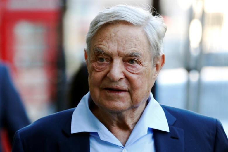 Business magnate George Soros arrives to speak at the Open Russia Club in London, Britain June 20, 2016. REUTERS/Luke MacGregor/Files