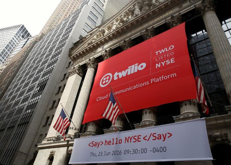 A banner for communications software provider Twilio Inc., hangs on the facade of the New York Stock Exchange (NYSE) to celebrate the company's IPO in New York City, U.S., June 23, 2016. REUTERS/Brendan McDermid