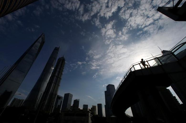 A man walks on a bridge in the financial district of Pudong in Shanghai, China June 22, 2016. REUTERS/Aly Song