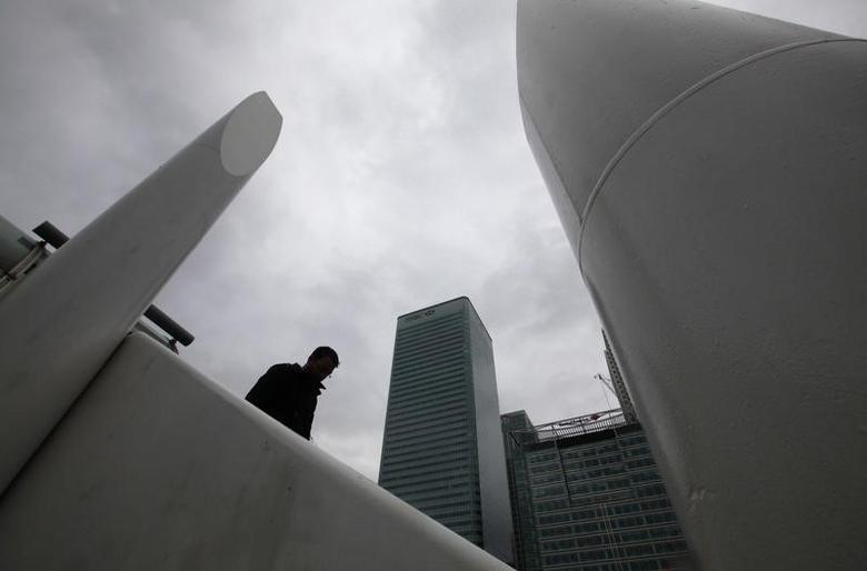 A man stands near the Canary Wharf business district, in east London February 28, 2011.  REUTERS/Andrew Winning