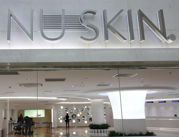 The logo of Nu Skin is seen at its ''experience centre'', where customers can sample and purchase the company's products, in Beijing January 21, 2014. REUTERS/Kim Kyung-Hoon (CHINA - Tags: BUSINESS LOGO)