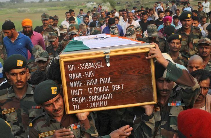 Indian army soldiers carry a coffin containing the body of their fallen colleague Ravi Paul, who was killed in Sunday's attack at an Indian army base in Kashmir's Uri, during his funeral in Sarwa village in Samba district, south of Jammu, September 19, 2016. REUTERS/Mukesh Gupta
