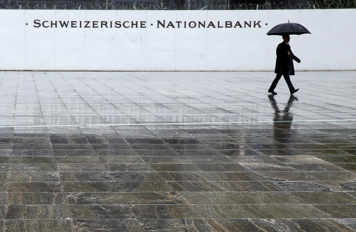 A man walks on the Federal Square in front of the Swiss National Bank (SNB) in Bern, Switzerland June 16, 2016. REUTERS/Ruben Sprich/File Photo