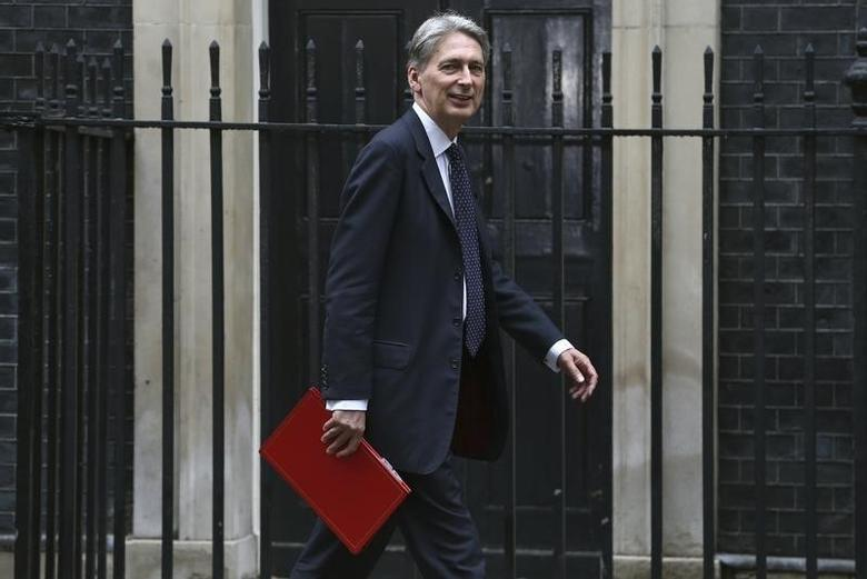Britain's Chancellor of the Exchequer Philip Hammond arrives for a meeting of the ''Cabinet Committee on Economy and Industrial Strategy'' at Number 10 Downing Street in London, Britain August 2, 2016. REUTERS/Neil Hall