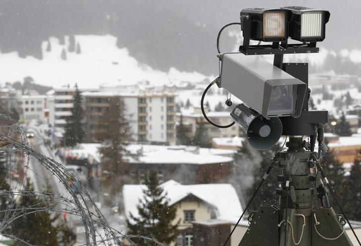 A camera is seen in front of the congress centre of the Swiss mountain resort of Davos January 24, 2011. REUTERS/Christian Hartmann/File Photo