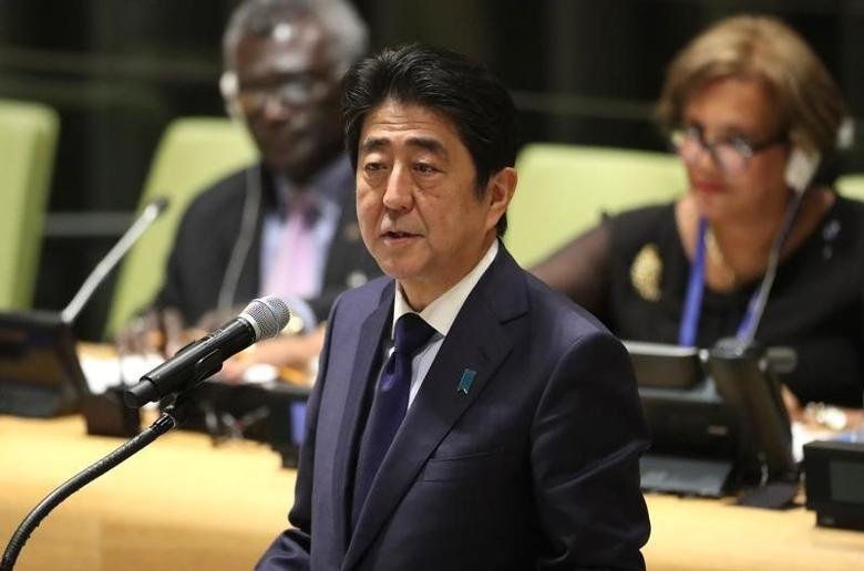 Japanese Prime Minister Shinzo Abe speaks during a high-level meeting on addressing large movements of refugees and migrants at the United Nations General Assembly in Manhattan, New York, U.S. September 19, 2016. REUTERS/Carlo Allegri