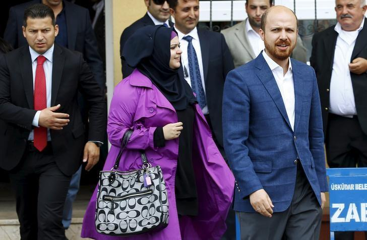 Bilal Erdogan (R), son of Turkish President Tayyip Erdogan, and his wife Reyvan Uzuner Erdogan leave a polling station after casting their votes during the parliamentary election in Istanbul, Turkey, June 7, 2015. REUTERS/Murad Sezer/File Photo