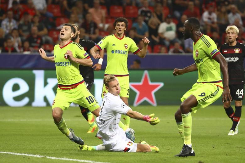 Football Soccer - Bayer 04 Leverkusen v CSKA Moscow - Champions League - BayArena, Leverkusen, Germany - 14/9/16. CSKA Moscow's Alan Dzagoev (L) reacts while scoring a goal past Bayer Leverkusen's goalkeeper Bernd Leno. REUTERS/Kai Pfaffenbach