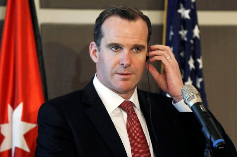 Brett McGurk, the United States' envoy to the coalition against Islamic State, listens to the translation during a news conference in Amman, Jordan, May 15, 2016. REUTERS/Muhammad Hamed