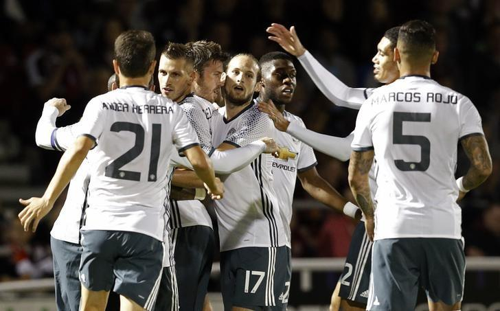 Britain Football Soccer - Northampton Town v Manchester United - EFL Cup Third Round - Sixfields Stadium - 21/9/16Manchester United's Michael Carrick celebrates scoring their first goal with team mates Reuters / Darren Staples/ Livepic