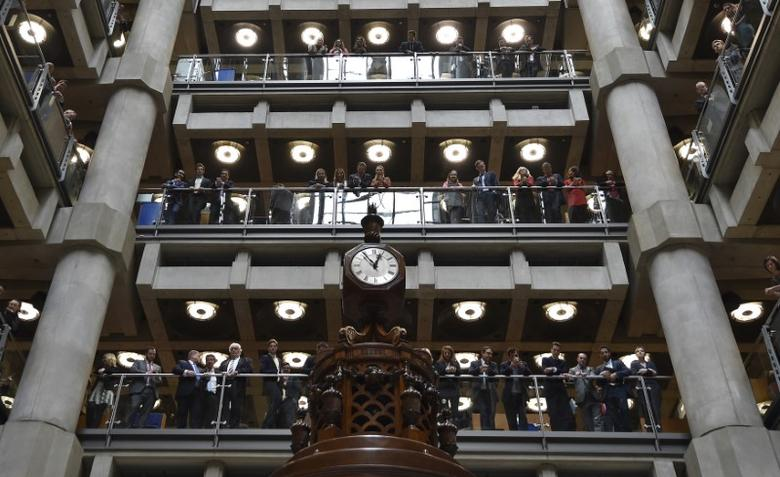 Employees look out over the main atrium of Lloyd's of London insurance market in the City of London October 24, 2014. REUTERS/Toby Melville