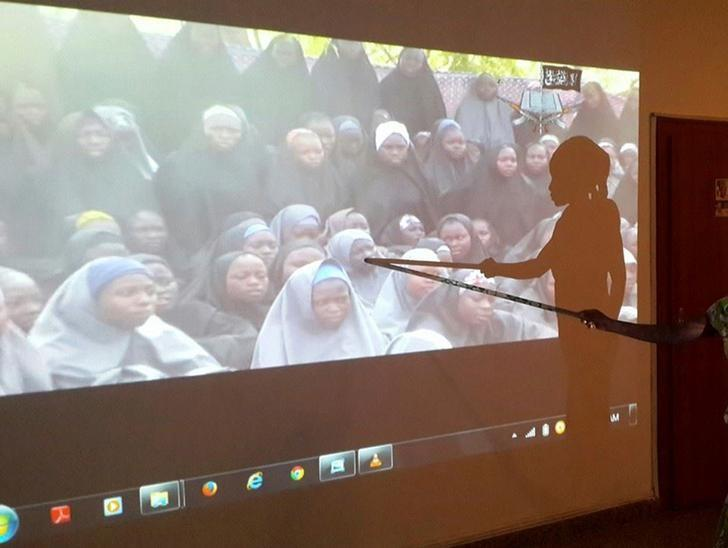 A student who escaped when Boko Haram rebels stormed a school and abducted schoolgirls, identifies her schoolmates from a video released by the Islamist rebel group at the Government House in Maiduguri, Borno State May 15, 2014.  REUTERS/Stringer/File photo