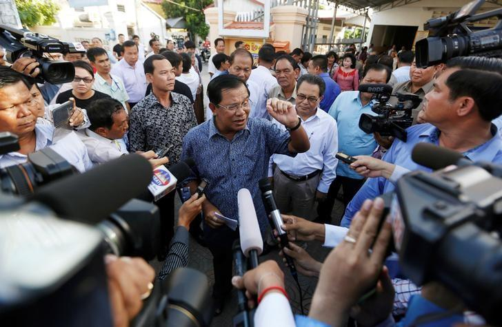 Cambodia's Prime Minister Hun Sen speaks to the media after registering for next year's local elections, in Kandal province, Cambodia September 1, 2016. REUTERS/Samrang Pring