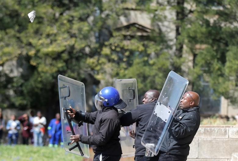 Students throw stones during clashes with security at Johannesburg's University of the Witwatersrand as countrywide protests demanding free tertiary education entered a third week, South Africa, September 20,2016. REUTERS/Siphiwe Sibeko
