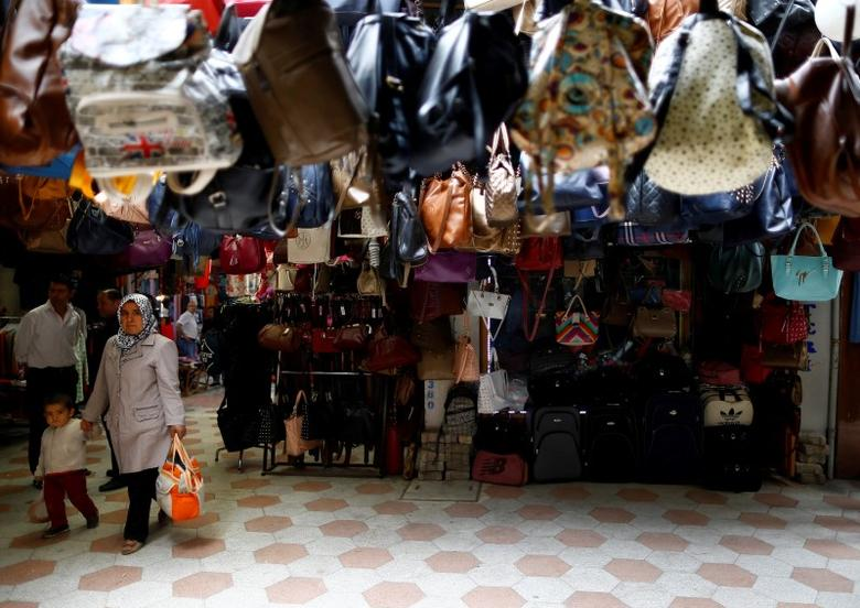 Shoppers walk in the main marketplace in the southeastern town of Kilis, Turkey, May 11, 2016. REUTERS/Osman Orsal