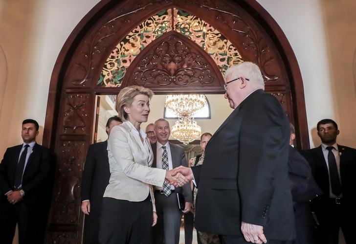 German Defence Minister Ursula von der Leyen shakes hands with Iraq's President Fuad Masum (R) after talks in Baghdad, Iraq, September 22, 2016. REUTERS/Michael Kappeler/POOL