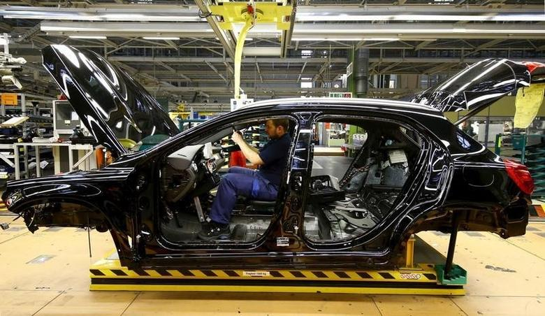 An employee of German car manufacturer Mercedes Benz works on the interior of a GLA model at their production line at the factory in Rastatt, Germany, January 22, 2016.    REUTERS/Kai Pfaffenbach/File Photo