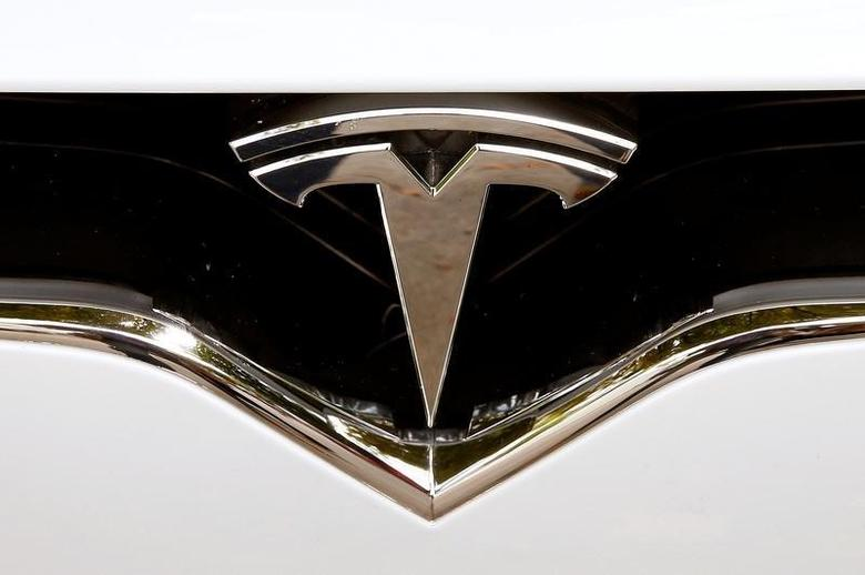 The company's logo is seen at a Model X car of U.S. manufacturer Tesla in Zurich, Switzerland August 17, 2016    REUTERS/Arnd Wiegmann