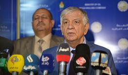 El ministro de Petróleo de Irak, Jabar Ali al-Luaibi, durante una conferencia de prensa en Basora, Irak. 27 de agosto de 2016. Irak busca mantener su participación en la producción petrolera mundial en entre 4,75 y 5 millones de barriles por día, dijo el ministro iraquí de Petróleo, Jabar Ali al-Luaibi, en un comunicado el jueves. REUTERS/Stringer