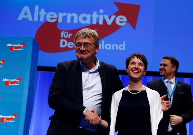 Frauke Petry, chairwoman of the anti-immigration party Alternative for Germany (AfD), and AfD leader Joerg Meuthen stand at the end of the second day of the AfD congress in Stuttgart, Germany, May 1,  2016. REUTERS/Wolfgang Rattay/File Photo