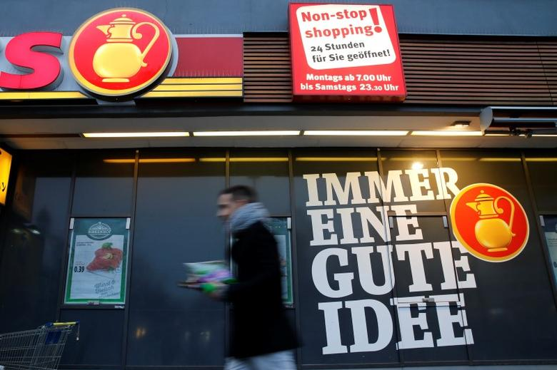 A man walks past grocery chain Kaiser's store in Berlin, Germany, January 12, 2016. German Economy Minister Sigmar Gabriel said he would approve plans by the country's biggest supermarket group Edeka to buy grocery chain Kaiser's, owned by retail group Tengelmann, but only as long as Edeka provided job guarantees for around 5 years. The words reads ''Always a good idea''. REUTERS/Fabrizio Bensch