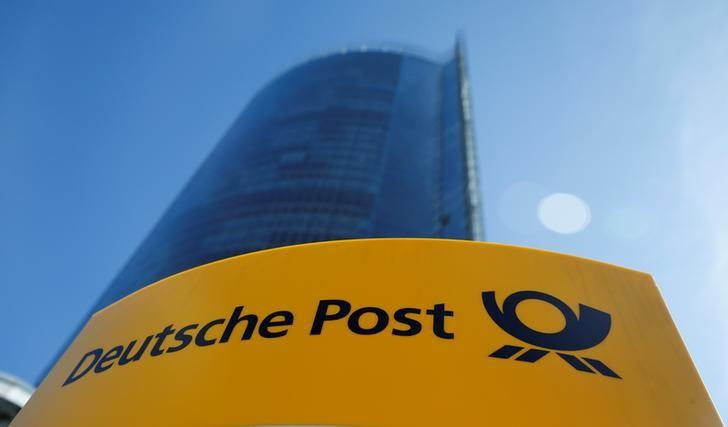A Deutche Post sign stands in front of the Bonn Post Tower, the headquarters of German postal and logistics group Deutsche Post DHL, in Bonn, Germany March 11, 2015.         REUTERS/Wolfgang Rattay/File Photo