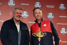 Sep 26, 2016; Chaska, MN, USA;  Europe team captain Darren Clarke (left) and Team USA captain Davis Love III pose for photographs after the captains press conference ahead of the 41st Ryder Cup at Hazeltine National Golf Club. Mandatory Credit: John David Mercer-USA TODAY Sports