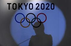 A shadow of of Tokyo governor Yuriko Koike is seen on the logo of Tokyo 2020 Olympic games during the Olympic and Paralympic flag-raising ceremony at Tokyo Metropolitan Government Building in Tokyo, Japan, September 21, 2016.  REUTERS/Toru Hanai