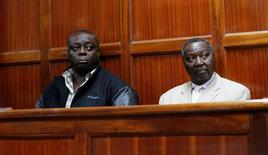 National Olympic Committee of Kenya (NOC-K) secretary general Francis Paul (R) and vice-chairman Pius Ochieng sit inside the dock at the Milimani Law court in Kenya's capital Nairobi, August 29, 2016. REUTERS/Thomas Mukoya