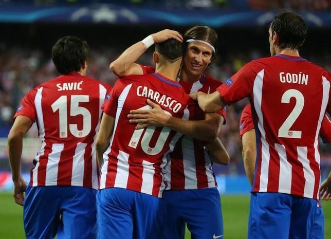 9月28日、サッカーの欧州CL1次リーグD組、アトレチコ・マドリードはホームでバイエルン・ミュンヘンを1─0で下した。写真は得点を喜ぶアトレチコの選手たち(2016年 ロイター)