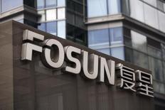 Штаб-квартира Fosun в Шанхае. Китайский конгломерат Fosun International Ltd намерен инвестировать в проект государственно-частного партнёрства стоимостью 46,2 миллиарда юаней ($6,92 миллиарда) по строительству высокоскоростной железнодорожной линии. Компания станет первой частной фирмой, участвующей в проекте китайской высокоскоростной железной дороги. REUTERS/Aly Song