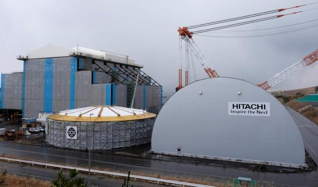 Hitachi logos are seen on Electric Power Development Co. (J-Power) Oma Nuclear Power Station under construction in Oma town, Aomori prefecture, Japan December 4, 2015. REUTERS/Kentaro Hamada/File Photo
