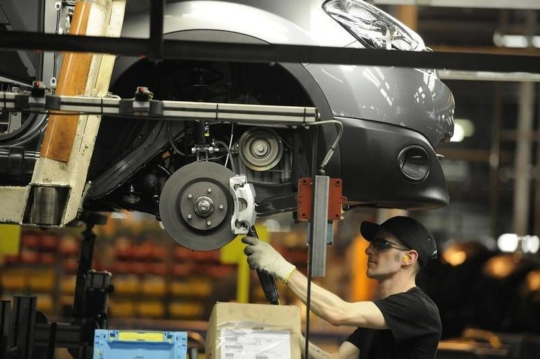 A Nissan technician prepares a Qashqai car at the company's plant in Sunderland, northern England November 9, 2011. REUTERS/Nigel Roddis/Files
