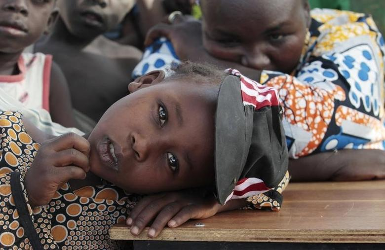 A girl displaced as a result of Boko Haram attack in the northeast region of Nigeria, rests her head on a desk at Maikohi secondary school camp for internally displaced persons (IDP) in Yola, Adamawa State January 13, 2015. REUTERS/Afolabi Sotunde