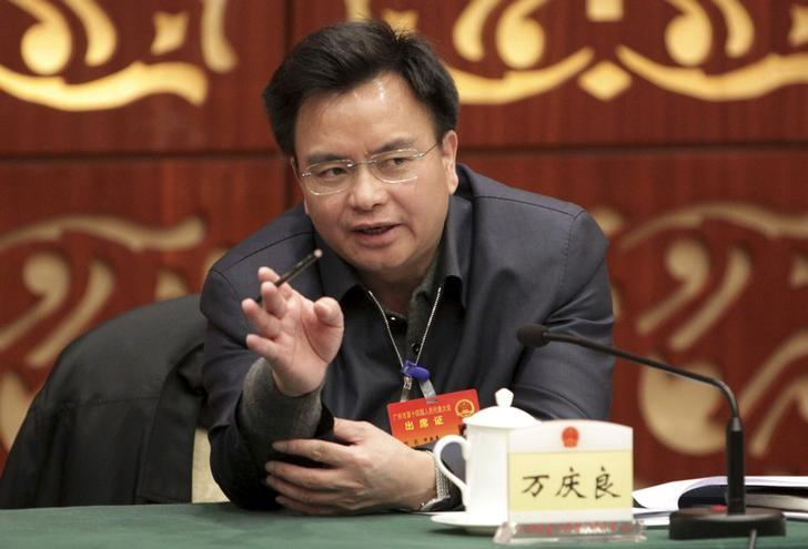 Wan Qingliang, former Communist Party boss of Guangzhou, gestures as he speaks at a meeting in Guangzhou, February 18, 2014. REUTERS/Stringer/Files