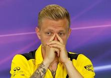 Renault's F1 driver Kevin Magnussen gestures during a news conference ahead of the Spanish Grand Prix. REUTERS/Albert Gea