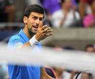 Sept 11, 2016; New York, NY, USA;   Novak Djokovic of Serbia talks to his box while playing Stan Wawrinka of Switzerland in the men's singles final on day fourteen of the 2016 U.S. Open tennis tournament at USTA Billie Jean King National Tennis Center. Mandatory Credit: Robert Deutsch-USA TODAY Sports
