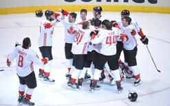 Team Canada players celebrate on the ice after defeating Team Europe 2-1 in game two of the World Cup of Hockey final to win the tournament at Air Canada Centre. Mandatory Credit: Dan Hamilton-USA TODAY Sports