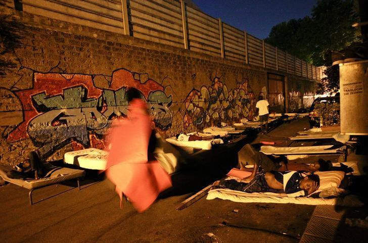 Migrants sleep at a makeshift camp in Via Cupa (Gloomy Street) in downtown Rome, Italy, August 2, 2016. REUTERS/Max Rossi/files