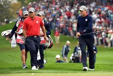 Sep 30, 2016; Chaska, MN, USA;  Jordan Spieth of the United States and  Patrick Reed of the United States on the eighth green in the morning foursome matches during the 41st Ryder Cup at Hazeltine National Golf Club. Mandatory Credit: John David Mercer-USA TODAY Sports